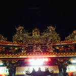 The night market is built around this temple.  People sit around outside and eat their night market snacks.